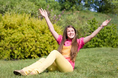 Pretty smiling girl open hands relaxing Stock Image