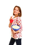 Pretty smiling girl with popcorn and a cup isolated on white bac Stock Photo