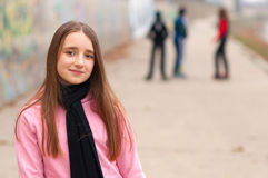 Pretty Smiling Girl Posing Outside With Friends Stock Image
