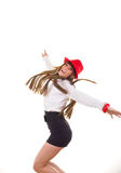 Pretty smiling girl with the red hat jumping Stock Photo