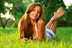 Pretty smiling girl relaxing Stock Images