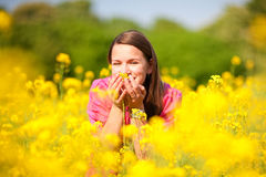 Pretty smiling girl relaxing on green meadow Royalty Free Stock Photography