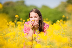 Pretty smiling girl relaxing on meadow Stock Photo