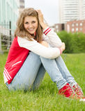 Pretty smiling girl relaxing outdoor Royalty Free Stock Image
