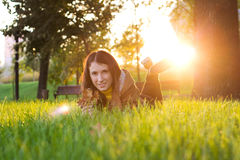 Pretty smiling girl relaxing outdoor Royalty Free Stock Photo