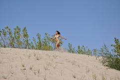 Pretty smiling girl on sand beach Stock Photos