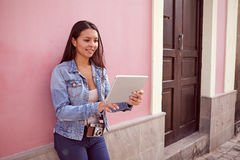 Pretty smiling girl with a tablet pc Stock Image