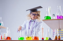 Pretty smiling girl working with reagents in lab Stock Photography