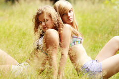 Pretty smiling girls relaxing outdoor Stock Photography