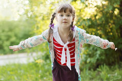 Pretty smiling little girl with braids Stock Photo