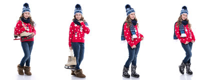 Pretty smiling little girl with curly hairstyle wearing knitted sweater, scarf and hat with skates isolated on white background. W Royalty Free Stock Photography