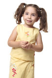 Pretty smiling little girl with ponytails Stock Image