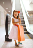 Pretty smiling little girl with shopping bag Stock Images