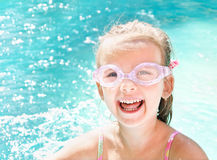 Pretty smiling little girl in swimming pool Royalty Free Stock Photo