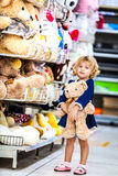 Pretty smiling little girl with teddy-bear in Royalty Free Stock Photography