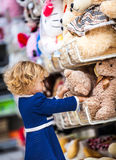 Pretty smiling little girl with teddy-bear in Stock Image