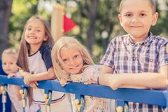 Pretty smiling little kids standing together stock images
