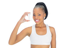 Pretty smiling model holding asthma inhaler Royalty Free Stock Photo