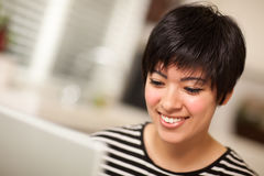 Pretty Smiling Multiethnic Woman Using Laptop Royalty Free Stock Photography