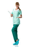 Pretty smiling nurse holding a folder Royalty Free Stock Image