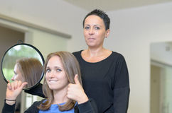 Pretty smiling 20s woman at hairdressers stock image