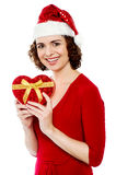 Pretty smiling santa woman with christmas gift Stock Photos