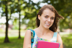 Pretty smiling student holding folder and notebook Royalty Free Stock Photos