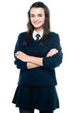Pretty smiling teenager looking at you confidently. Arms folded Stock Photo