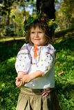 Pretty smiling Ukrainian girl. Pretty little girl dressed in Ukrainian folk costume Stock Photos