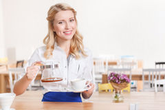 Pretty smiling waitress in cafeteria Stock Photography