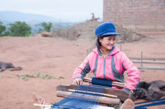 A pretty smiling weaving girl Stock Photo