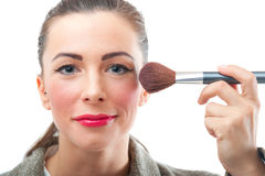 Pretty smiling woman applying make up Royalty Free Stock Photos