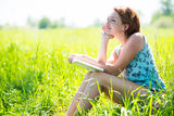 Pretty smiling woman with book at nature Royalty Free Stock Photo