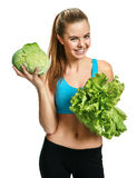 Pretty smiling woman with cabbage and lettuce, organic food, health and beauty care concept Royalty Free Stock Photos