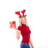 Pretty smiling  woman with christmas gift Stock Image