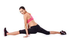 Pretty smiling woman doing the splits Royalty Free Stock Photography