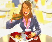 Pretty smiling woman eating a hamburger Royalty Free Stock Image