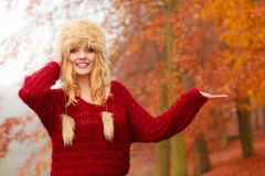 Pretty smiling woman in fur hat with copy space. Stock Image
