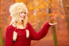 Pretty smiling woman in fur hat with copy space. Stock Images