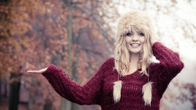 Pretty smiling woman in fur hat with copy space. Royalty Free Stock Photos