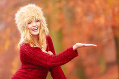 Pretty smiling woman in fur hat with copy space. Royalty Free Stock Image