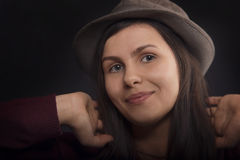 Pretty smiling woman in hat, close up portrait Royalty Free Stock Photography