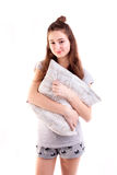 Pretty smiling woman hold pillow isolated Royalty Free Stock Photos