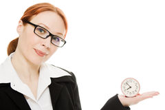 Pretty smiling woman holding a clock Stock Photo