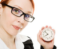 Pretty smiling woman holding a clock Stock Photography