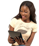 Pretty smiling woman holding digital tablet. African American smiling woman using digital tablet PC against white background royalty free stock photos