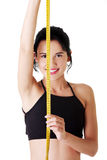 Pretty smiling woman holding measurement type Royalty Free Stock Images
