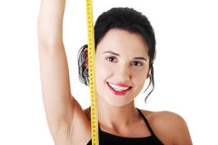 Pretty smiling woman holding measurement type. Stock Images