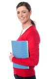 Pretty smiling woman holding notebook Royalty Free Stock Photos