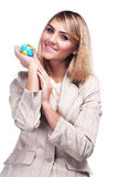Pretty smiling woman holding a world globe. Business woman Royalty Free Stock Photography